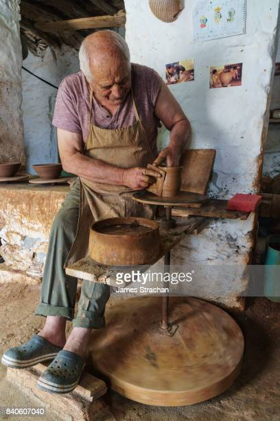 kostas depastas, traditional clay potter, at his wheel in his workshop - potter stock pictures, royalty-free photos & images