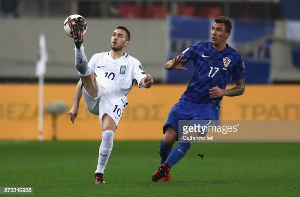 Kostas Fortounis of Greece and Mario Mandzukic of Croatia in action during the FIFA 2018 World Cup Qualifier PlayOff Second Leg between Greece and...