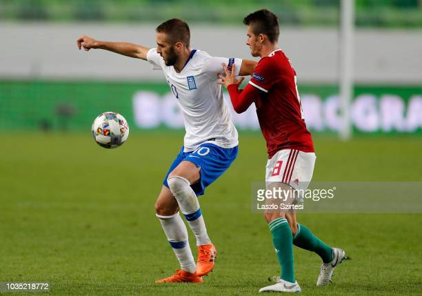 Kostas Fortounis of Greece competes for the ball with Adam Nagy of Hungary during the UEFA Nations League group stage match between Hungary and...