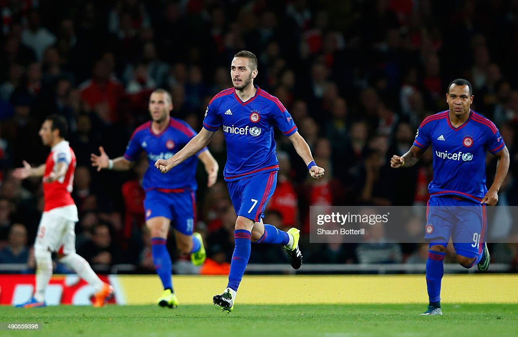 Kostas Fortounis of Olympiacos celebrates the own goal scored by David Ospina of Arsenal during the UEFA Champions League Group F match between Arsenal FC and Olympiacos FC at the Emirates Stadium on September 29, 2015 in London, United Kingdom.