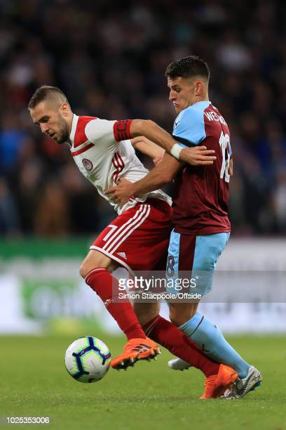 Kostas Fortounis of Olympiakos battles with Ashley Westwood of Burnley during the UEFA Europa League Qualifying PlayOff Second Leg match between...