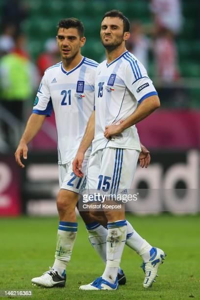 Kostas Katsouranis and Vasilis Torosidis of Greece look on during the UEFA EURO 2012 group A match between Greece and Czech Republic at The Municipal...