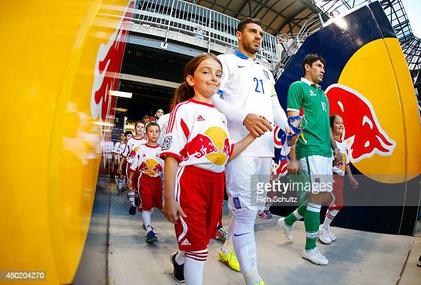 Kostas Katsouranis of Greece and Ronald Raldes of Bolivia lead their teams onto the pitch before the first half of an international friendly match at...