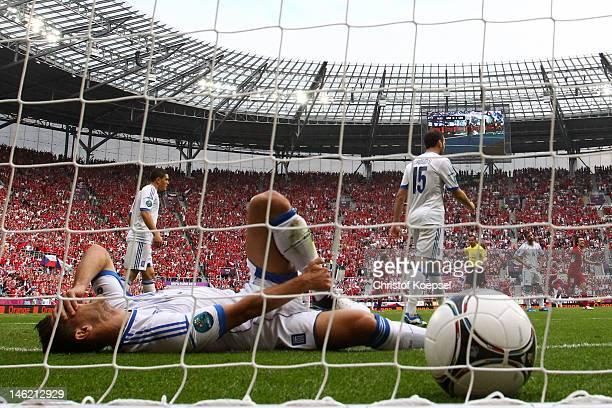 Kostas Katsouranis of Greece lies in the goal after Vaclav Pilar of Czech Republic scored their second goal during the UEFA EURO 2012 group A match...
