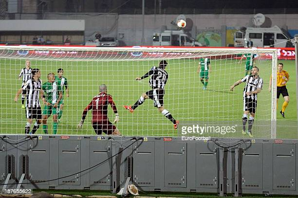 Kostas Katsouranis of PAOK FC heads the ball clear from danger during the UEFA Europa League group stage match between Maccabi Haifa FC and PAOK FC...