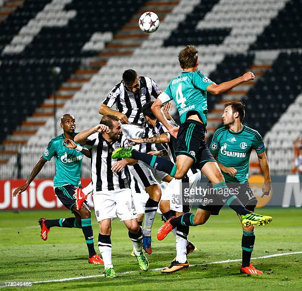 Kostas Katsouranis of PAOK vies for a header during the UEFA Champions League second leg playoff match between PAOK Saloniki and FC Schalke 04 at...