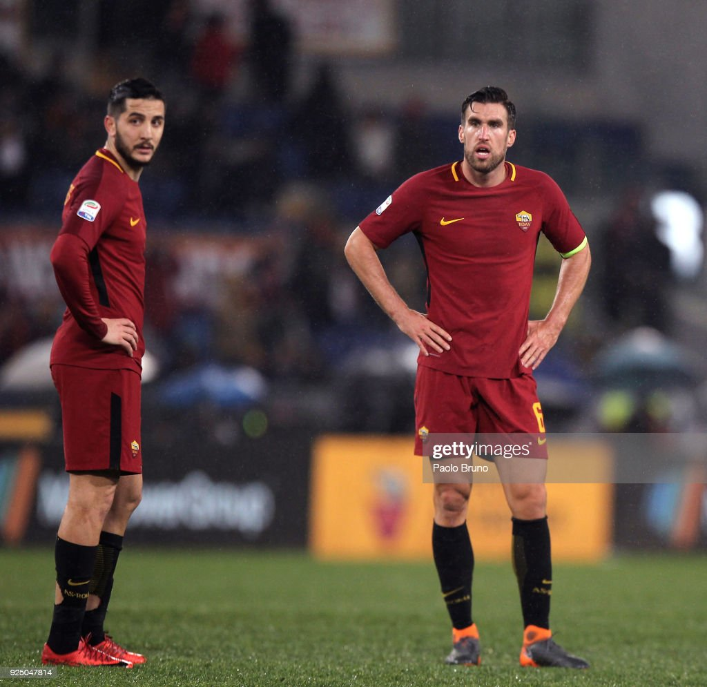 Kostas Manolas and Kevin Strootman of AS Roma react during the serie A match between AS Roma and AC Milan at Stadio Olimpico on February 25, 2018 in Rome, Italy.
