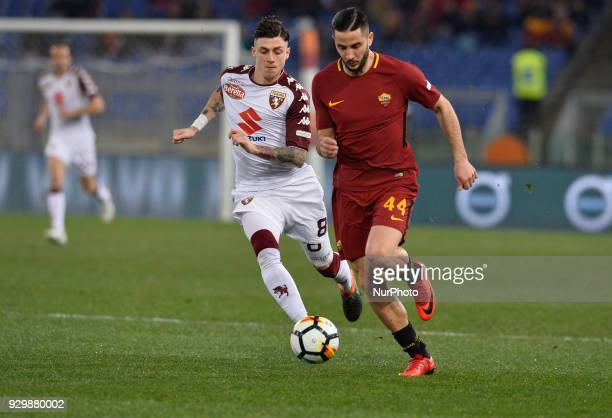 Kostas Manolas Daniele Baselli during the Italian Serie A football match between AS Roma and FC Torino at the Olympic Stadium in Rome on march 09 2018