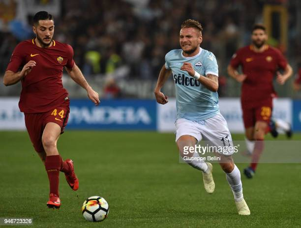 Kostas Manolas of AS Roma and Ciro Immobile of SS Lazio in action during the serie A match between SS Lazio and AS Roma at Stadio Olimpico on April...