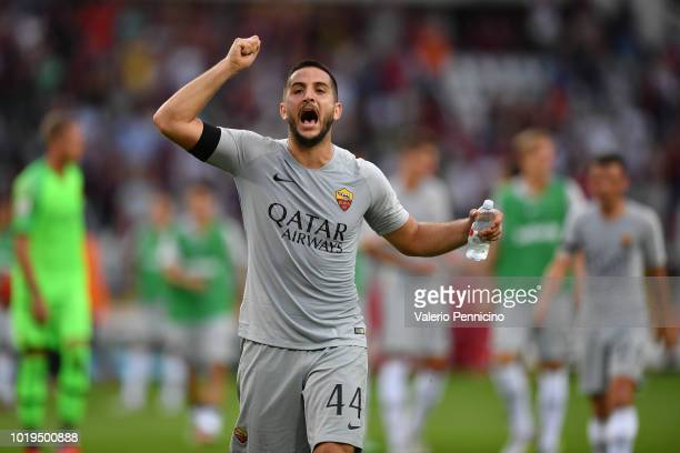 Kostas Manolas of AS Roma celebrates victory at the end of the Serie A match between Torino FC and AS Roma at Stadio Olimpico di Torino on August 19...