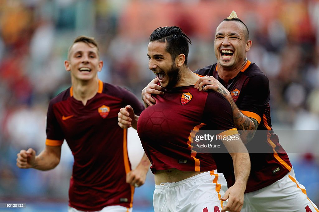 Kostas Manolas (C)of AS Roma celebrates with his teammates Lucas Digne (L) and Radja Nainngolan after scoring the opening goal during the Serie A match between AS Roma and Carpi FC at Stadio Olimpico on September 26, 2015 in Rome, Italy.