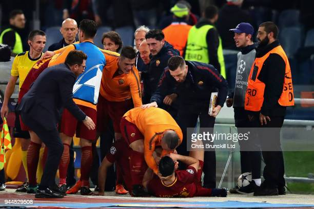 Kostas Manolas of AS Roma lies on the floor in celebration after scoring his sides third goal during the UEFA Champions League Quarter Final second...