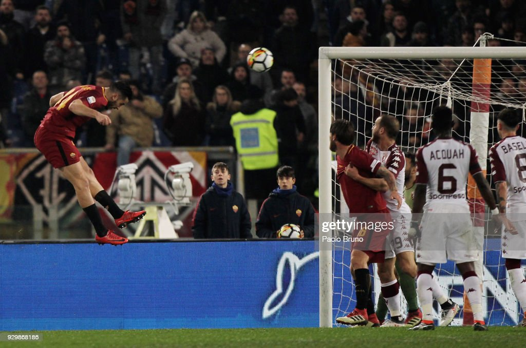 Kostas Manolas of AS Roma scores the opening goal during the Serie A match between AS Roma and Torino FC at Stadio Olimpico on March 9, 2018 in Rome, Italy.