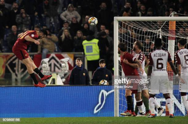 Kostas Manolas of AS Roma scores the opening goal during the Serie A match between AS Roma and Torino FC at Stadio Olimpico on March 9 2018 in Rome...