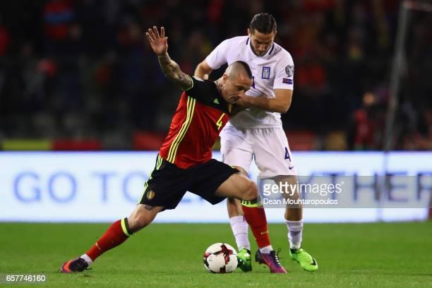Kostas Manolas of Greece and Radja Nainggolan of Belgium battle for the ball during the FIFA 2018 World Cup Group H Qualifier match between Belgium...