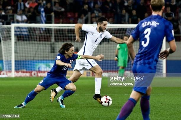 Kostas Manolas of Greece in action against Luka Modric of Croatia during the World Cup Russia 2018 European Qualifiers match between Greece and...