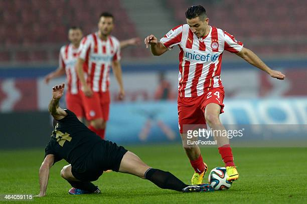Kostas Manolas of Olympiacos dribbles past Pedro Sass Petrazzi of Levadiakos with the ball during the Greek Superleague match between Olympiacos and...