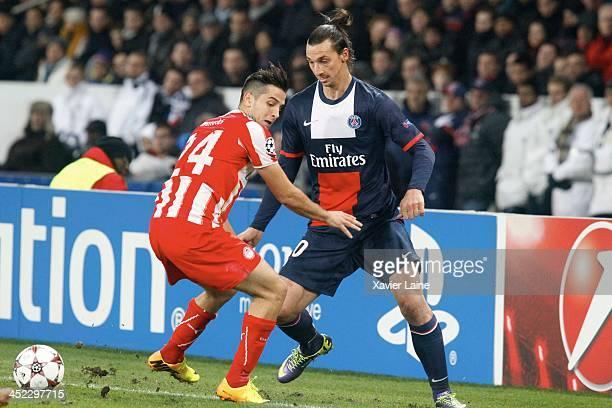 Kostas Manolas of Olympiacos FC and Zlatan Ibrahimovic of Paris SaintGermain during the UEFA Champions League between Paris SaintGermain FC and...