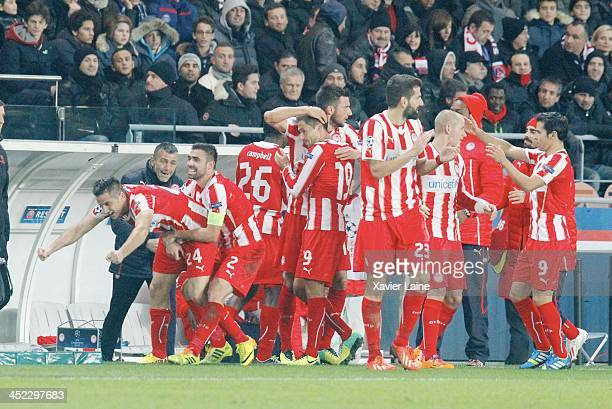 Kostas Manolas of Olympiacos FC celebrate his goal with teammatte during the UEFA Champions League between Paris SaintGermain FC and Olympiacos FC at...