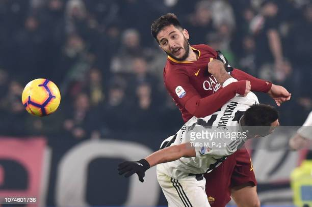 Kostas Manolas of Roma and Mario Mandzukic of Juventus compete for the ball during the Serie A match between Juventus and AS Roma on December 22 2018...