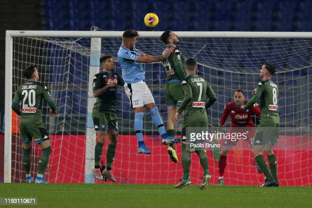 Kostas Manolas of SSC Napoli competes for the ball with Sergej Milinkovic Savic of SS Lazio during the Serie A match between SS Lazio and SSC Napoli...