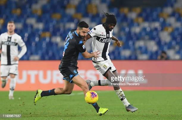 Kostas Manolas of SSC Napoli vies with Gervinho of Parma Calcio during the Serie A match between SSC Napoli and Parma Calcio at Stadio San Paolo on...