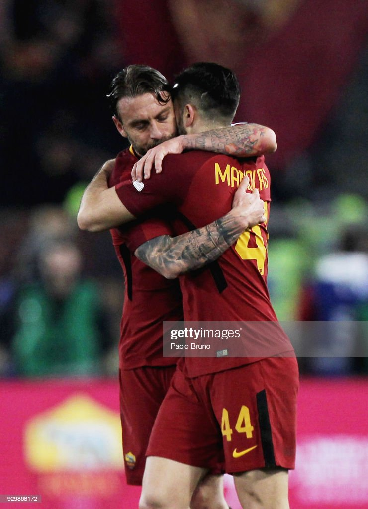 Kostas Manolas with his teammate Daniele De Rossi of AS Roma celebrates after scoring the opening goal during the Serie A match between AS Roma and Torino FC at Stadio Olimpico on March 9, 2018 in Rome, Italy.