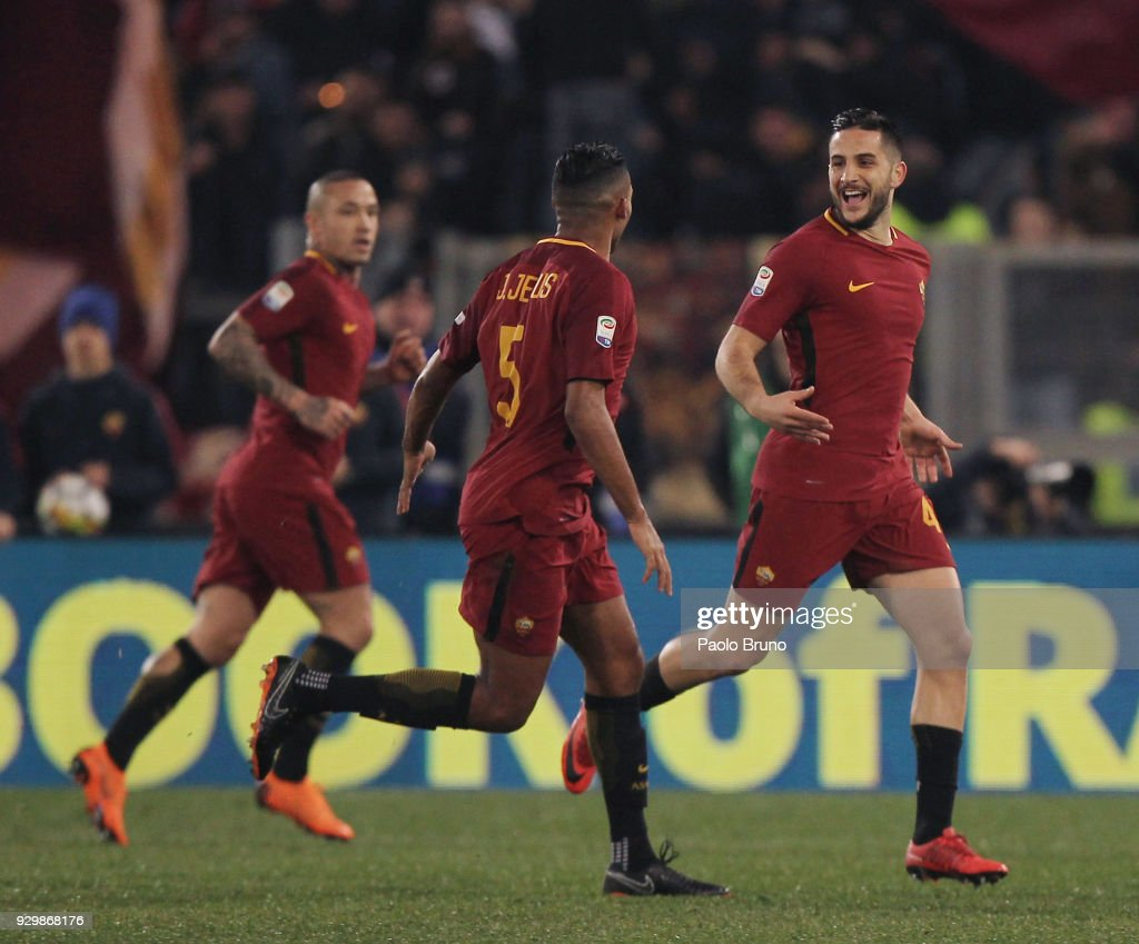 Kostas Manolas with his teammates of AS Roma celebrates after scoring the opening goal during the Serie A match between AS Roma and Torino FC at Stadio Olimpico on March 9, 2018 in Rome, Italy.