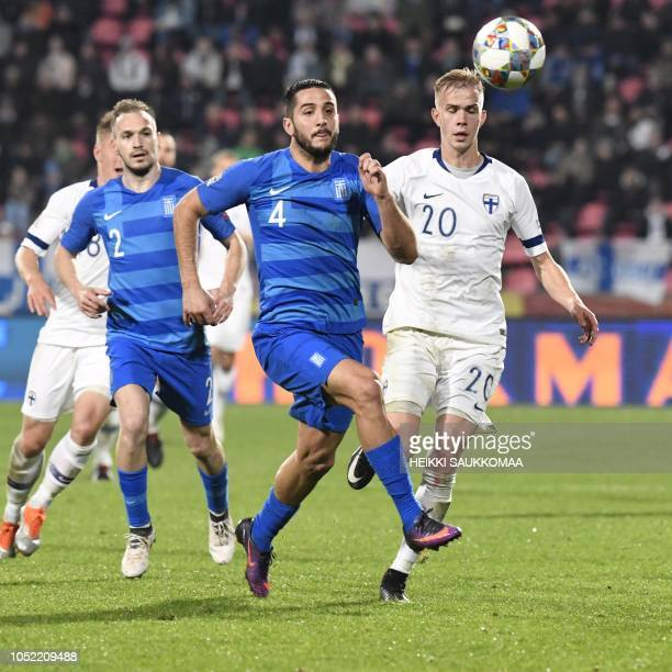 Kostas Manolos of Greece and Jasse Tuominen of Finland vie for the ball during the UEFA Nations League group stage football match Finland v Grece in...