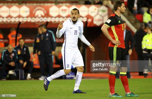 Kostas Mitroglou of Greece celebrates his goal while Jan Vertonghen of Belgium looks on during the FIFA 2018 World Cup Qualifier between Belgium and...