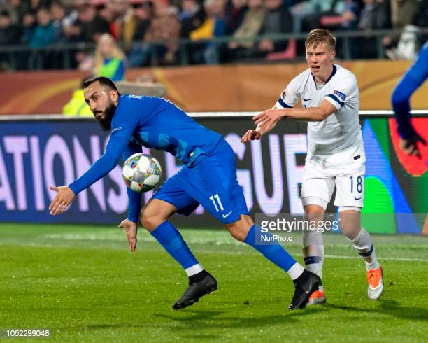 Kostas Mitroglou of Greece vies Jere Uronen of Finland during the UEFA Nations League group stage football match Finland v Grece in Tampere Finland...