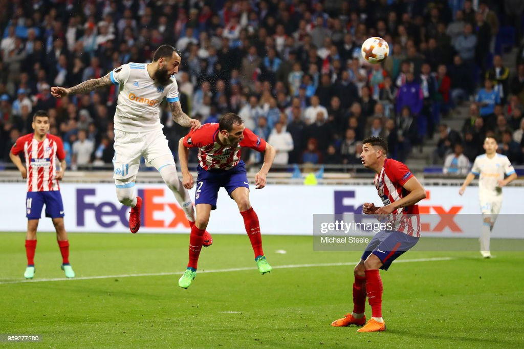 Kostas Mitroglou of Marseille heads goalwards under pressure from Diego Godin of Atletico Madrid during the UEFA Europa League Final between Olympique de Marseille and Club Atletico de Madrid at Stade de Lyon on May 16, 2018 in Lyon, France.