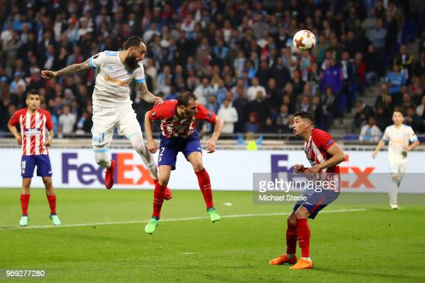 Kostas Mitroglou of Marseille heads goalwards under pressure from Diego Godin of Atletico Madrid during the UEFA Europa League Final between...