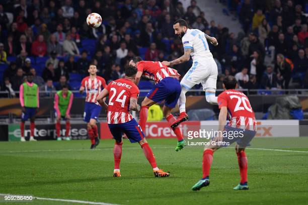 Kostas Mitroglou of Marseille heads the ball under pressure from Antoine Griezmann of Atletico Madrid during the UEFA Europa League Final between...