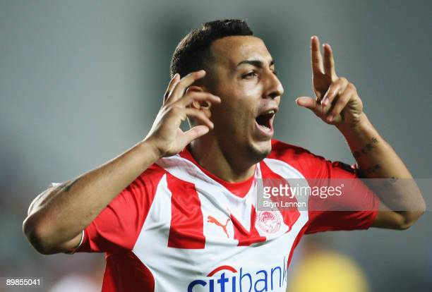 Kostas Mitroglou of Olympicaos FC celebrates scoring during the UEFA Champions League qualifying match between FC Sheriff and Olympiacos FC on August...