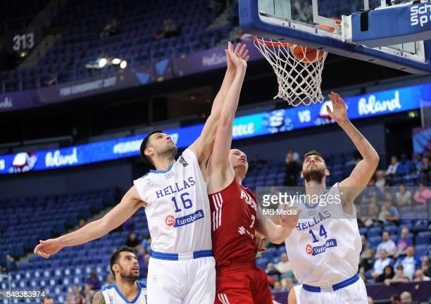 Kostas Papanikolaou of Greece Damian Kulig of Poland Georgios Papagiannis of Greece during the FIBA Eurobasket 2017 Group A match between Greece and...