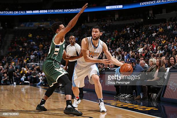 Kostas Papanikolaou of the Denver Nuggets controls the ball against Rashad Vaughn of the Milwaukee Bucks at Pepsi Center on November 11 2015 in...