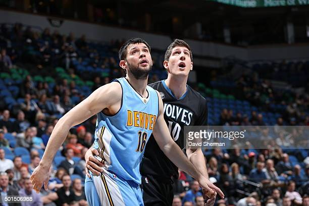 Kostas Papanikolaou of the Denver Nuggets fights for position against Damjan Rudez of the Minnesota Timberwolves on December 15 2015 at Target Center...