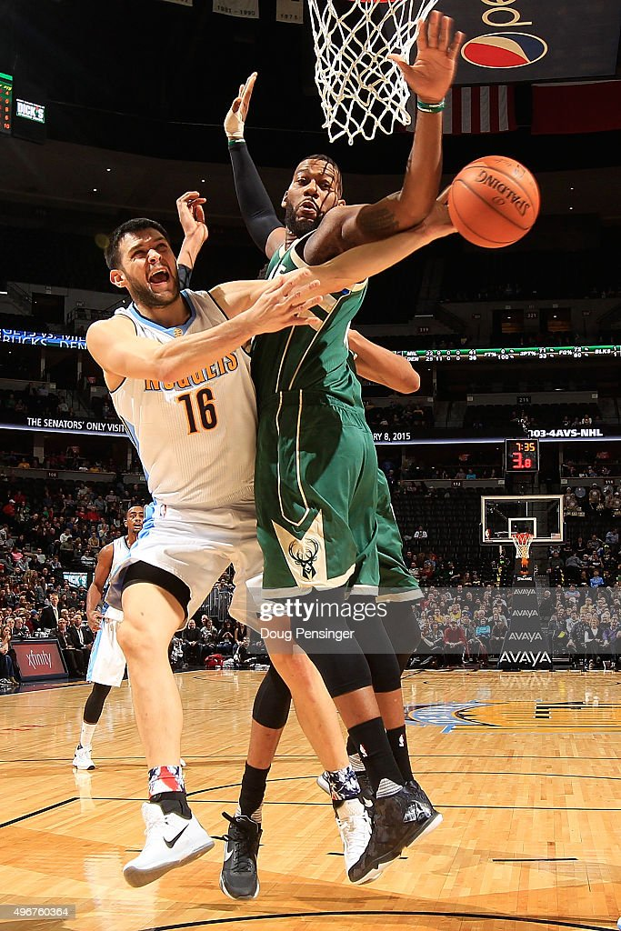 Kostas Papanikolaou #16 of the Denver Nuggets is fouled by Greg Monroe #15 of the Milwaukee Bucks at Pepsi Center on November 11, 2015 in Denver, Colorado. The Nuggets defeated the Bucks 103-102.