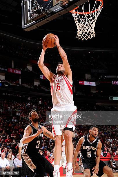 Kostas Papanikolaou of the Houston Rockets grabs the rebound against the San Antonio Spurs during the game on October 24 2014 at the Toyota Center in...