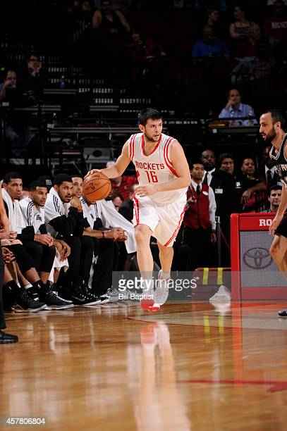 Kostas Papanikolaou of the Houston Rockets handles the ball against the San Antonio Spurs during the game on October 24 2014 at the Toyota Center in...