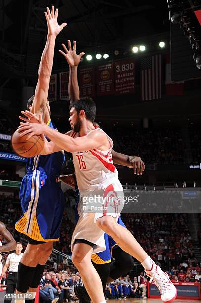 Kostas Papanikolaou of the Houston Rockets passes the ball against the Golden State Warriors during the game on November 8 2014 at the Toyota Center...