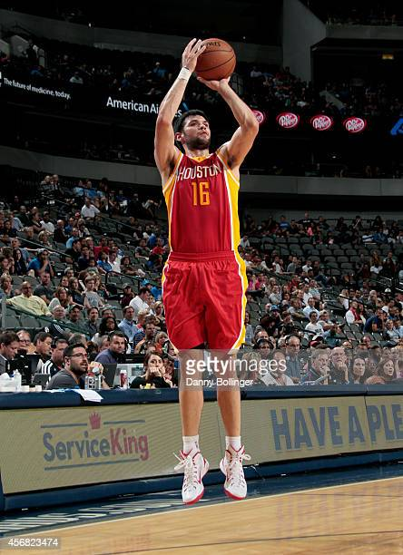 Kostas Papanikolaou of the Houston Rockets shoots a jumper against the Dallas Mavericks on October 7 2014 at the American Airlines Center in Dallas...