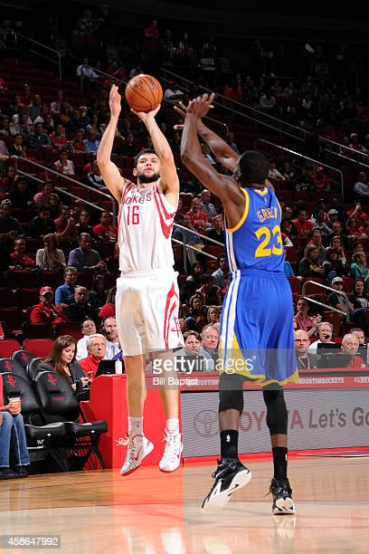 Kostas Papanikolaou of the Houston Rockets shoots the ball against the Golden State Warriors during the game on November 8 2014 at the Toyota Center...