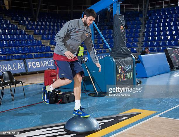 Kostas Papanikolau #16 of FC Barcelona warms up before the 20132014 Turkish Airlines Euroleague Regular Season Date 10 game between FC Barcelona v...