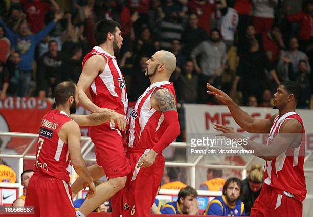 Kostas Papanikolau #16 of Olympiacos Piraeus celebrates with his teammate Pero Antic during the 20122013 Turkish Airlines Euroleague Top 16 Date 14...