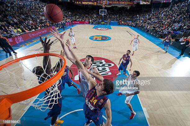 Kostas Papanikolau #16 of Olympiacos Piraeus in action during the 20122013 Turkish Airlines Euroleague Top 16 Date 3 between FC Barcelona Regal v...
