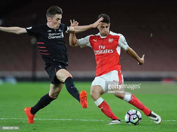 Kostas Pileas of Arsenal passes under pressure from Harry Wilson of Liverpool during the match between Arsenal U23 and Liverpool U23 at Emirates...