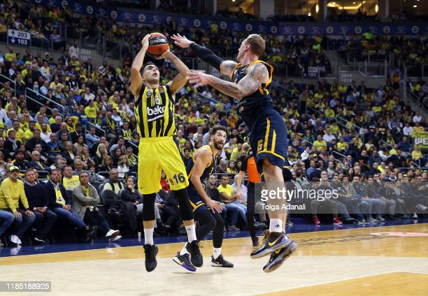 Kostas Sloukas #16 of Fenerbahce Beko Istanbul in action with Janis Timma #6 of Khimki Moscow Region