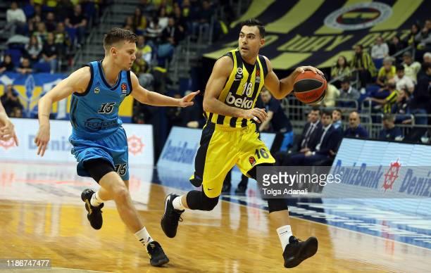 Kostas Sloukas #16 of Fenerbahce Beko Istanbul in action with Martin Hermannsson #15 of Alba Berlin